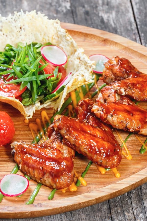 Chicken wings on plate with vegetables