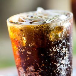 Cranberry Coke in a glass with ice