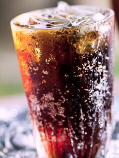 Cranberry Coke in a tall glass with ice