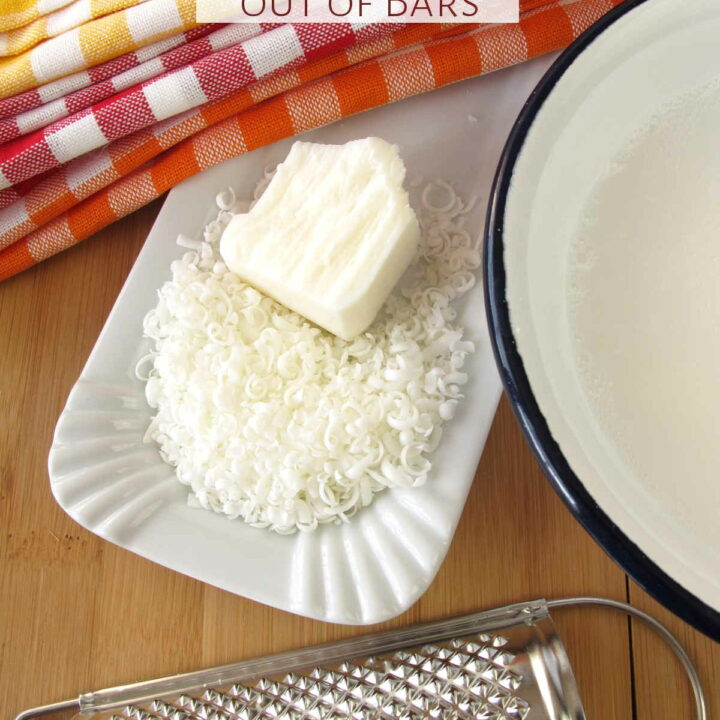 Grated bar soap in dish on table