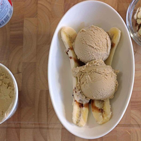 Banana halves with chocolar syrup and coffee ice cream