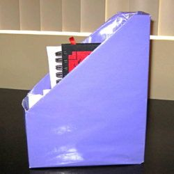 Make a magazine holder out of a cereal box