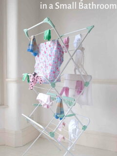 Drying rack with clothes in small bathroom