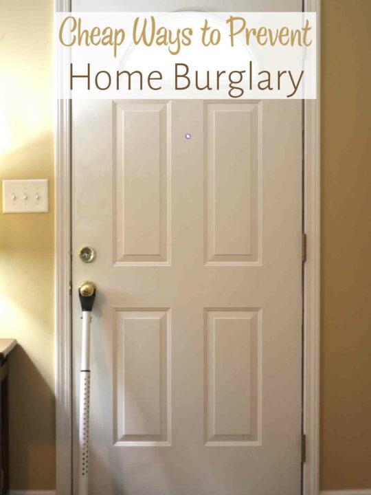Front door with door jammer under handle