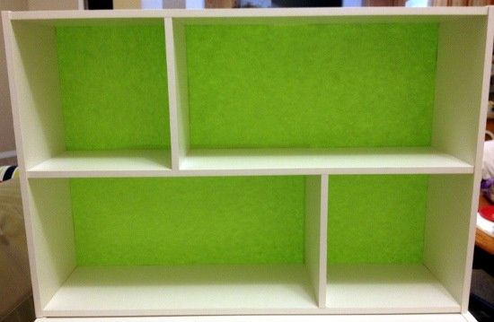 Small modular shelf with complete green backing