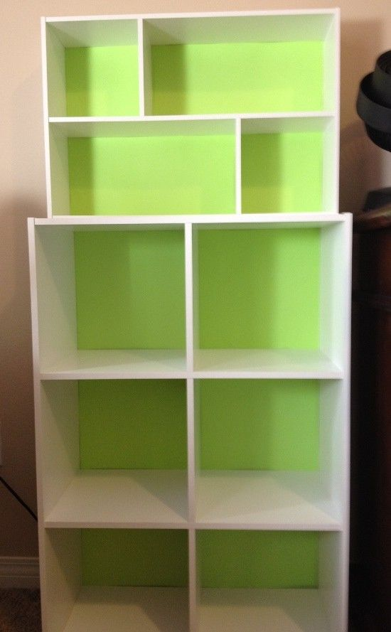 Finished modular shelves with green backing stacked