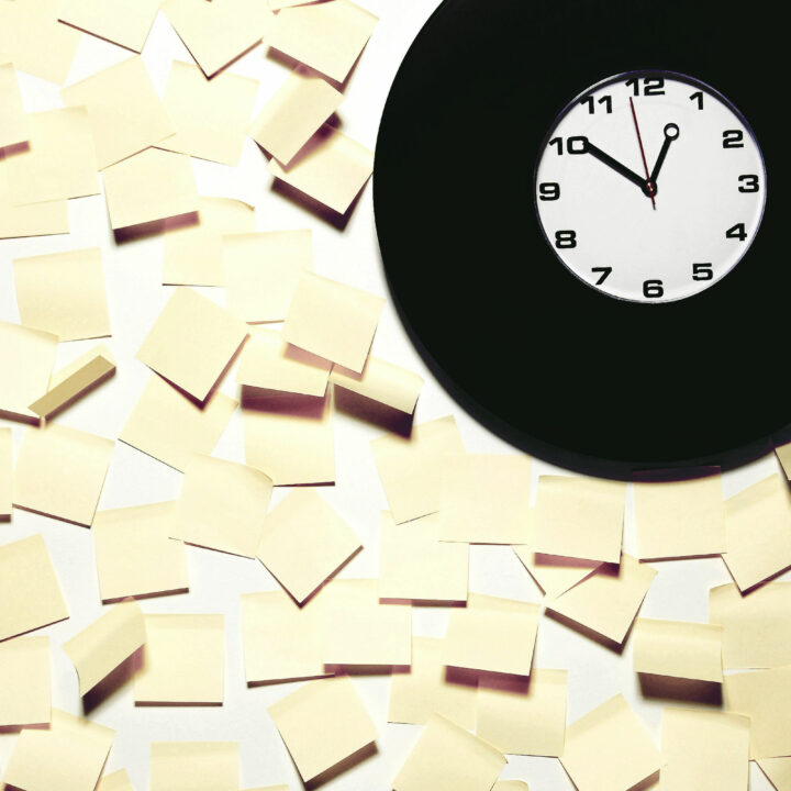 Clock surrounded by sticky notes