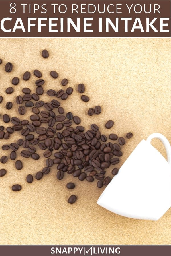 Coffee beans spilling out of cup with text overlay - 8 Tips to Reduce Your Caffeine Intake