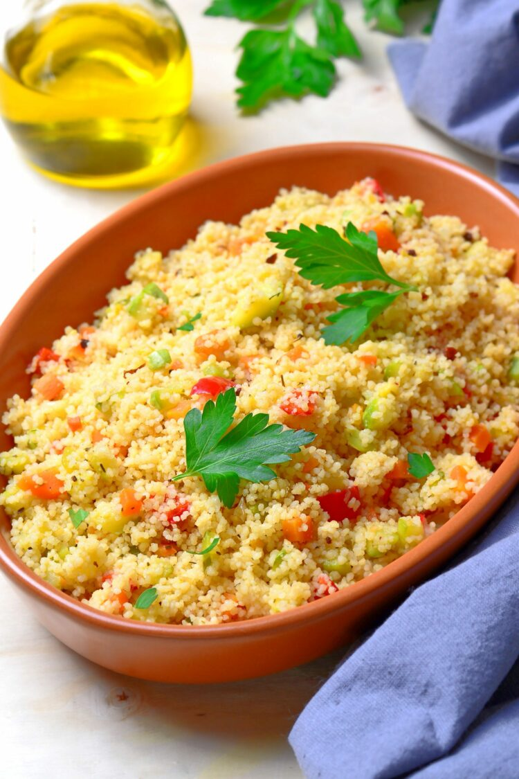 Couscous salad in bowl on table