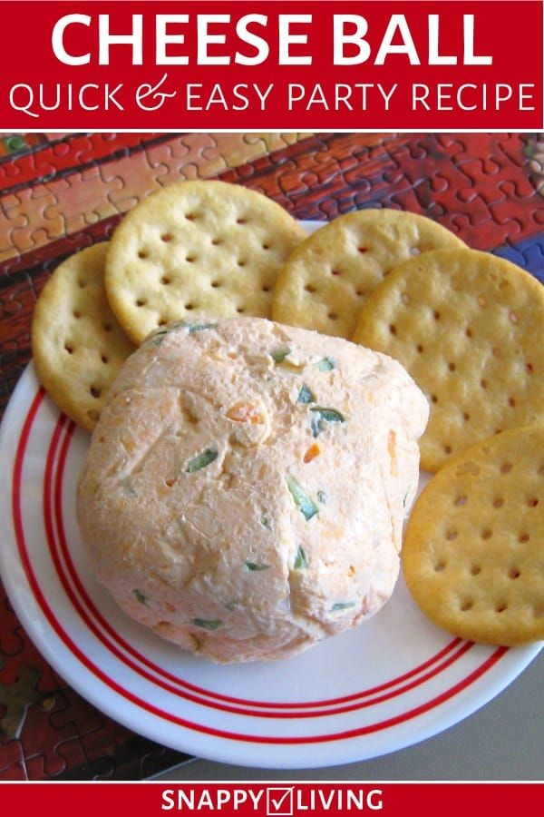 Homemade cheese ball from recipe with crackers on plate