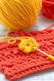 Yellow and orange yarn with crochet hook