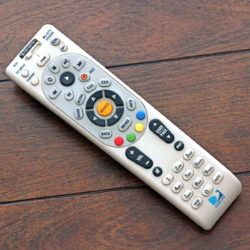 DirecTV remote laying on table
