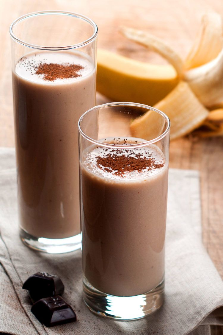 Chocolate banana smoothies on table with bananas