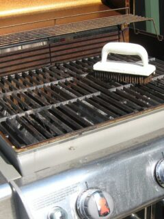 Dirty grill being cleaned
