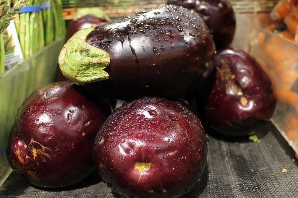 Once you learn how to cook eggplant, you'll find it's a delicious filling veggie that can substitute for meat. These are my tips for picking good ones and cooking them well, along with some eggplant recipes. #eggplantrecipes #cooking #recipes #eggplant #vegetarianmeal