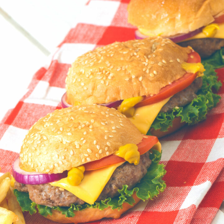 Burgers in a row on a napkin