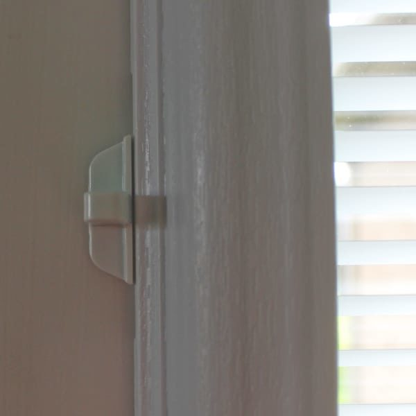 Door blinds adjustment slider on frame