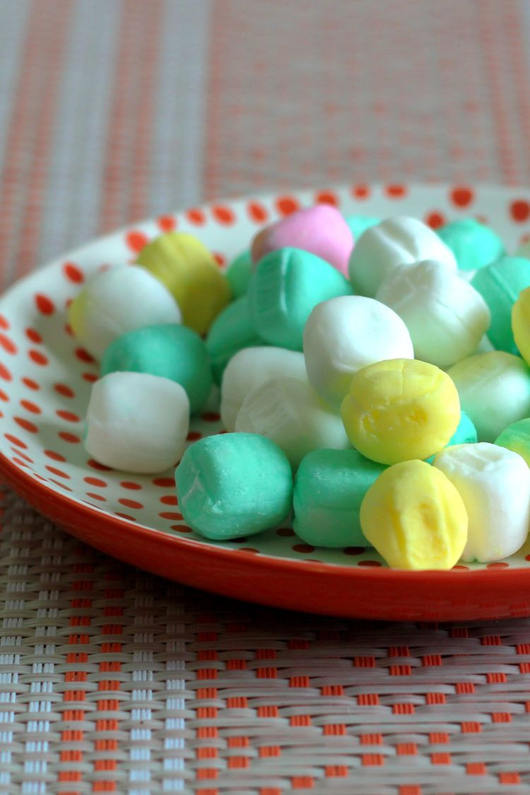 Colorful butter mints on saucer
