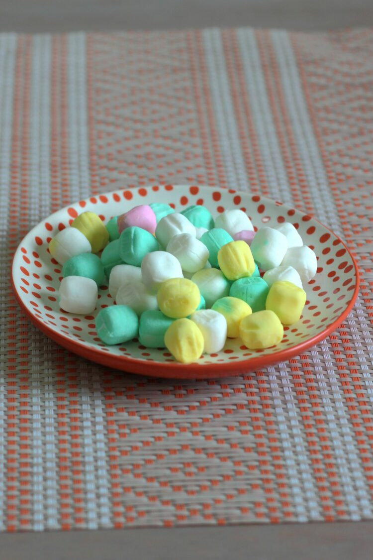 Butter mints candies on saucer on placemat