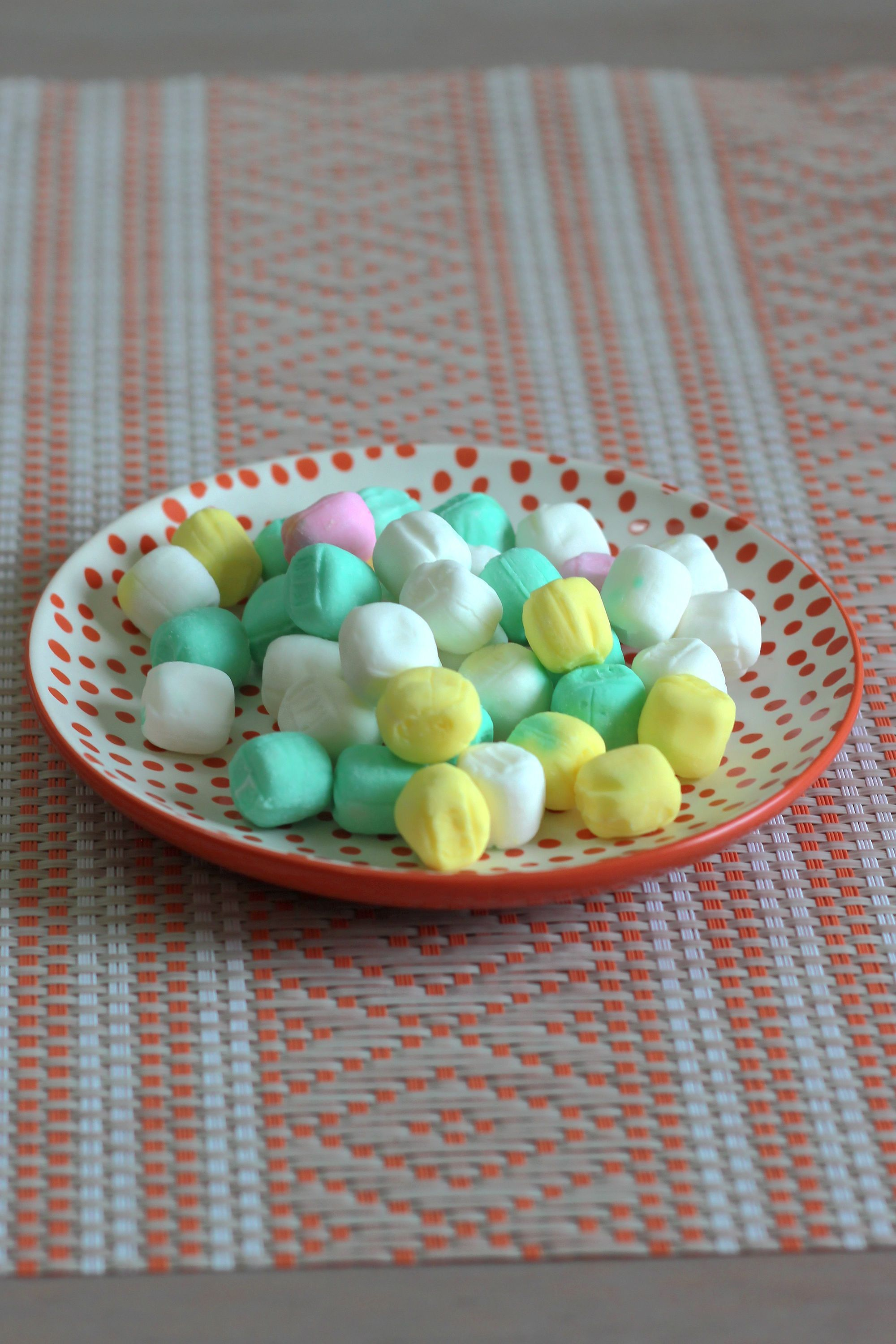 Bowl of butter mint candies on table