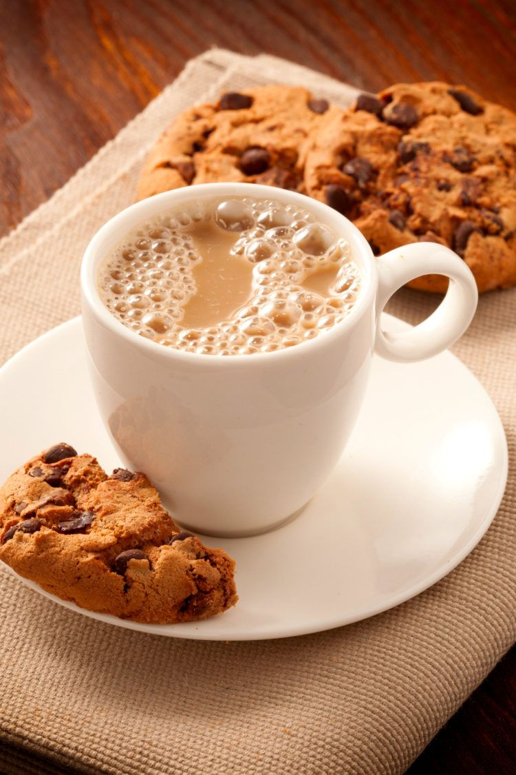 Homemade mocha in mug served with chocolate chip cookies