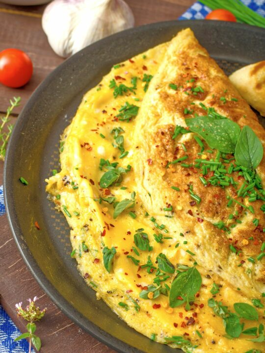 Herb and spice omelet in a pan