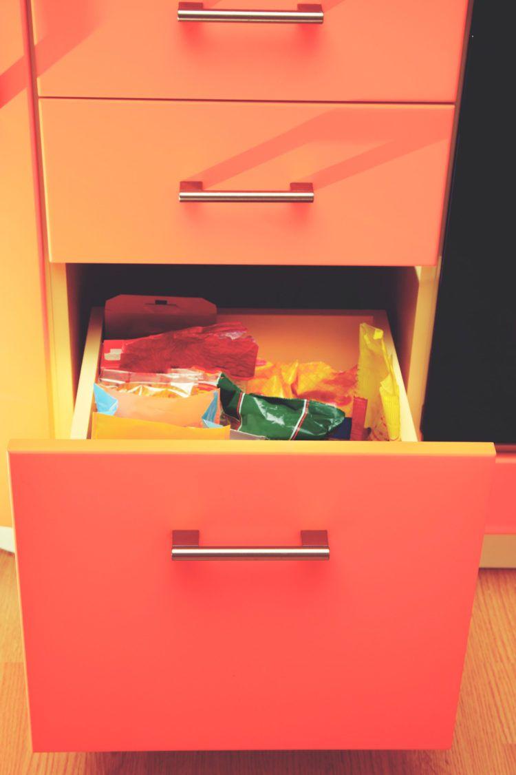 Orange dresser with open drawer