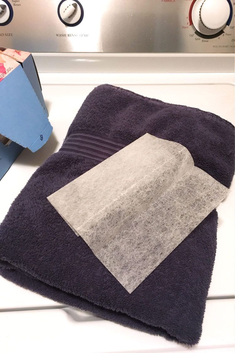 Towel and dryer sheet on top of washer