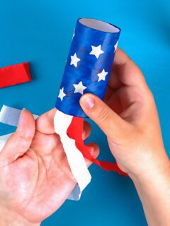 Hands making Fourth of July crafts