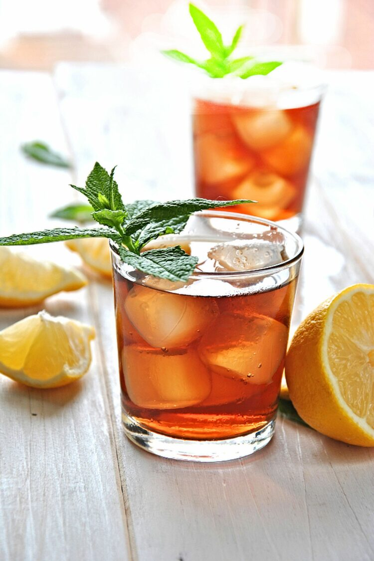 Southern sweet tea in glasses with mint garnish