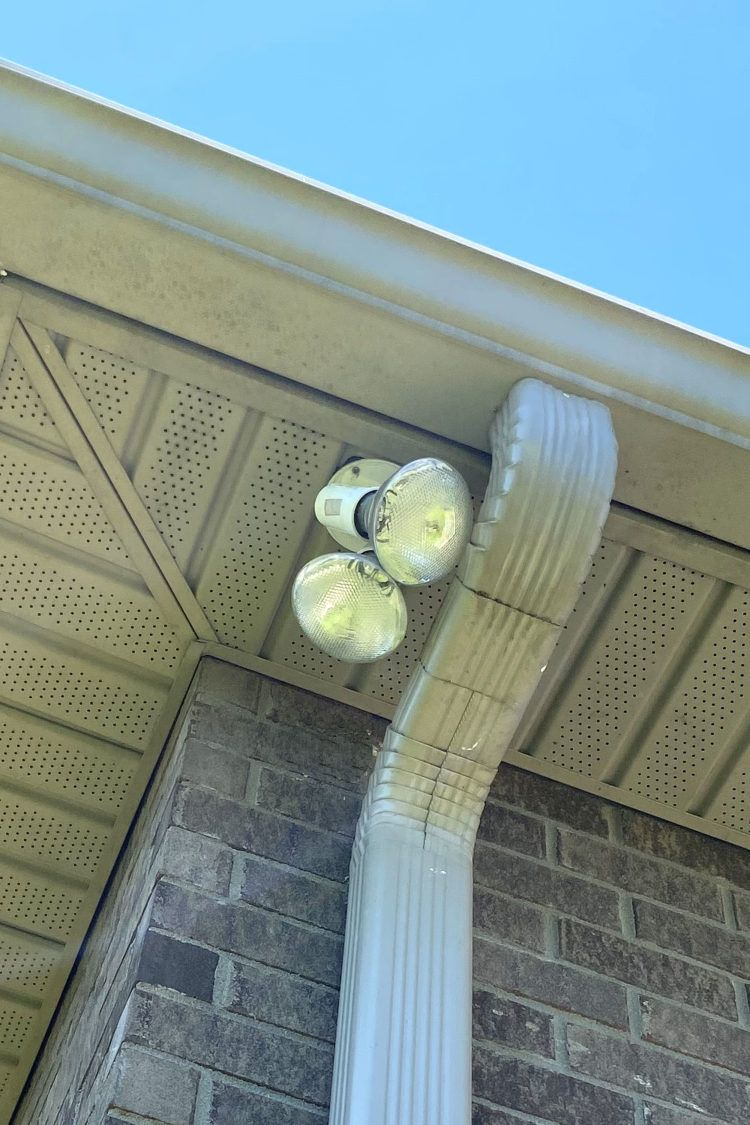 Closeup of exterior home security lights attached to eaves