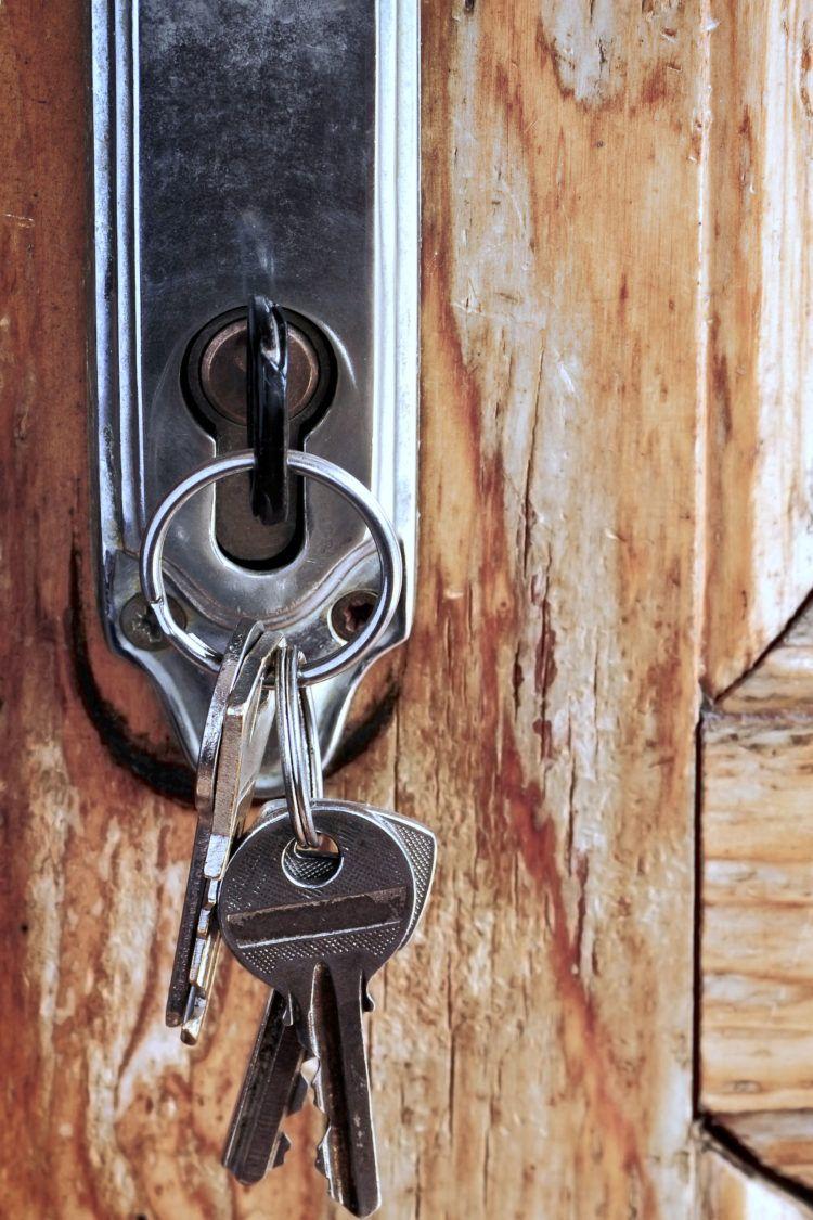 Keys in front door home security deadbolt