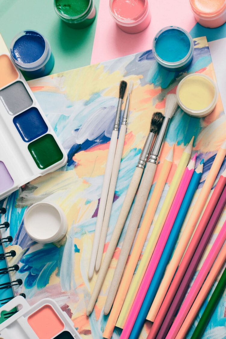 Craft supplies including paints and brushes