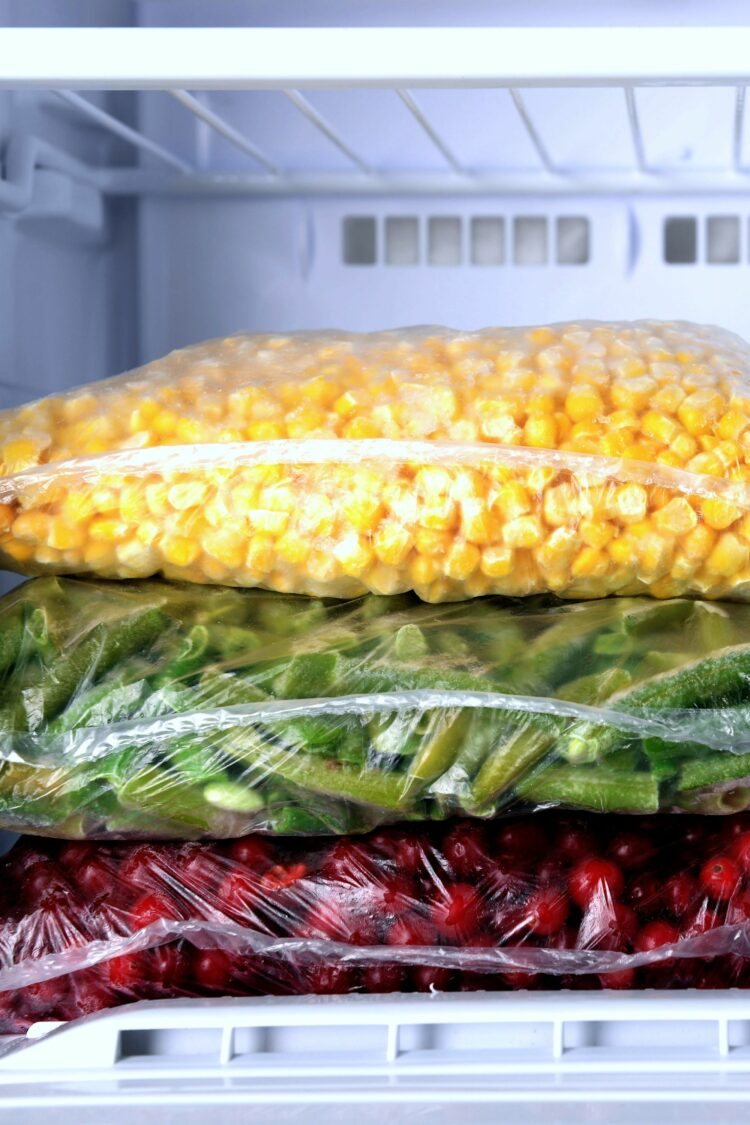 Food items in freezer bags inside freezer