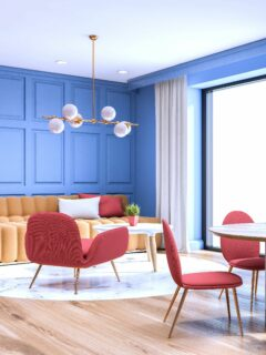 Blue paneled room with table and chairs