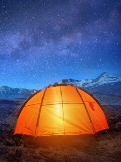 Tent outdoors under night sky