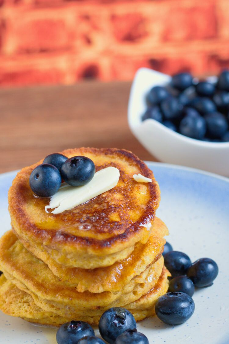 Pancakes on plate with blueberries